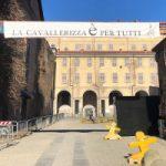 """Veduta Cavallerizza Reale dall'entrata di via Verdi, striscione """"La Cavallerizza è per tutti"""""""