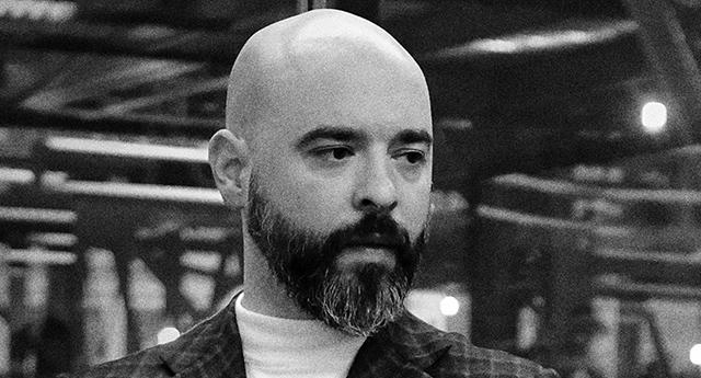 Foto in bn di uomo calvo con baffi e barba - Loris Pignoletti